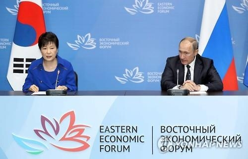 This photo, taken on Sept. 3, 2016, shows President Park Geun-hye (L) speaking during a joint press conference following her summit with Russian President Vladimir Putin on the sidelines of the Eastern Economic Forum in Russia's Far East port city of Vladivostok. (Yonhap)
