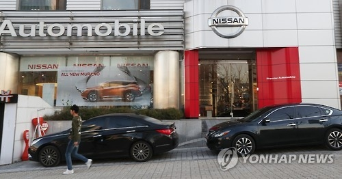 A man walks past an outlet of the South Korean unit of Nissan Motor Co. in Seoul on Nov. 29, 2016. (Yonhap)