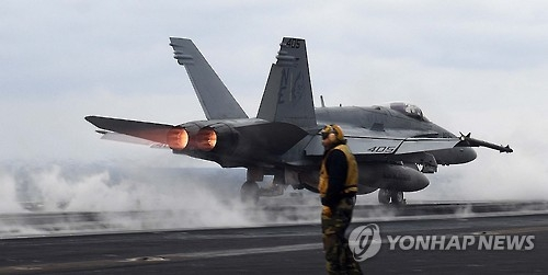 In this photo taken on March 14, 2017, and provided by Joint Press Corps of South Korea's Defense Ministry, an F/A-18 fighter jet is about to take off on the USS Carl Vinson aircraft carrier in the East Sea. (Yonhap)