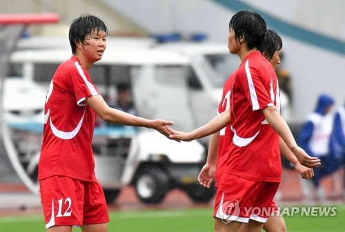 North Korean forward Kim Yun-mi (L) celebrates with her teammates after scoring a goal against Hong Kong in their 2018 AFC Women's Asian Cup Group B qualifying match at Kim Il-sung Stadium in Pyongyang on April 5, 2017. (Joint Press Corps)
