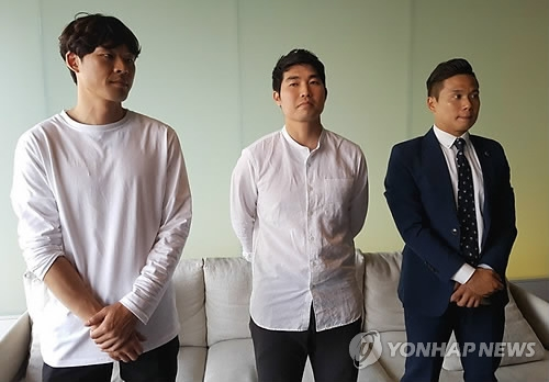 South Korea's professional footballers' union executives speak to reporters at a Seoul hotel on June 8, 2017. From left are Kwak Hee-ju, Kim Han-sup and Kim Hoon-ki. (Yonhap)