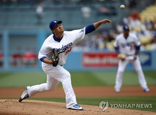 In this Associated Press photo, Ryu Hyun-jin of the Los Angeles Dodgers delivers a pitch against the Cincinnati Reds in their Major League Baseball regular season game at Dodger Stadium in Los Angeles on June 11, 2017. (Yonhap)
