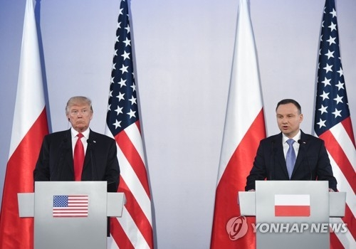 U.S. President Donald Trump holds a joint news conference with Poland's President Andrzej Duda in Warsaw on July 6. (EPA-Yonhap)