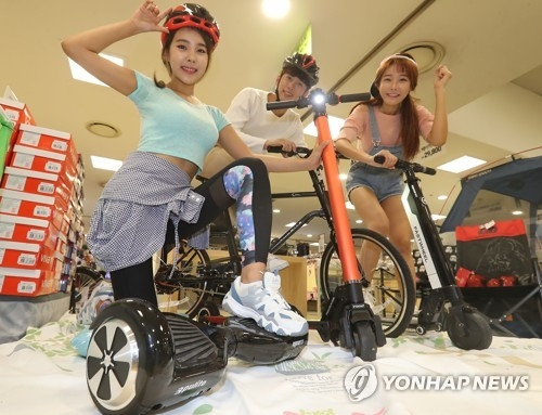 (Yonhap Feature) Personal mobility devices expanding fast but face hurdles - 1