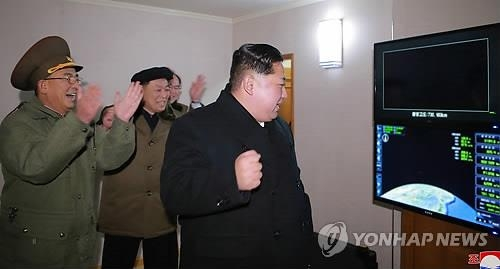 North Korean leader Kim Jong-un pumps his fist while he watches the flight data of the Hwasong-15 missile in this photo released by the country's media. (For Use Only in the Republic of Korea. No Redistribution) (Yonhap)