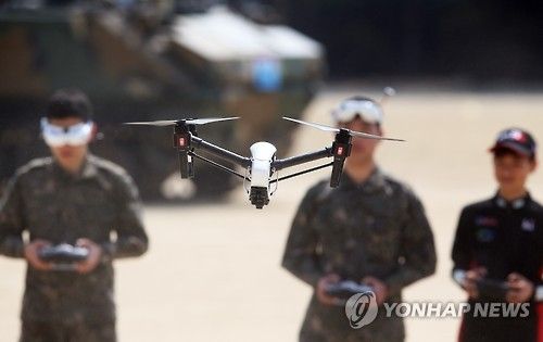 South Korean soldiers test-fly drones in this file photo. (Yonhap)