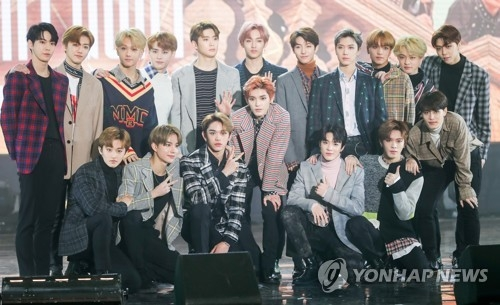 "In this file photo, NCT pose for photos at a media showcase for its album, ""NCT 2018 Empathy,"" at Korea University's Hwajung Gymnasium in Seoul on March 14, 2018. (Yonhap)"