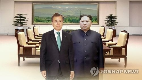 This image, provided by Yonhap News TV, shows President Moon Jae-in (L) and his North Korean counterpart Kim Jong-un. (Yonhap)