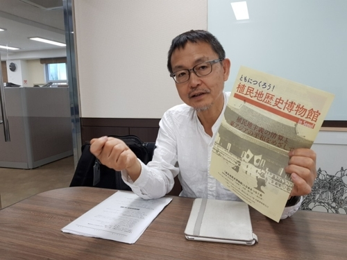 Japanese activist Hideki Yano gestures during an interview with Yonhap News Agency in Seoul on June 9, 2018. (Yonhap)