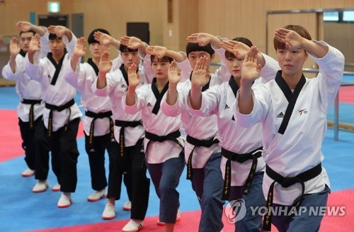 South Korean taekwondo poomsae practitioners practice their moves at the National Training Center in Jincheon, North Chungcheong Province, on Aug. 8, 2018. (Yonhap)