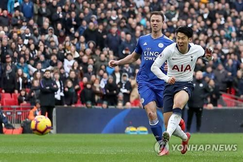 In this AFP photo, Tottenham Hotspur's South Korean forward Son Heung-min (R) scores his team's third goal during the English Premier League football match between Tottenham Hotspur and Leicester City at Wembley Stadium in London on February 10, 2019. (Yonhap)