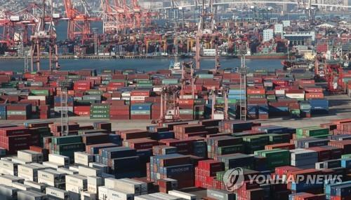 This undated photo shows containers carrying export goods in Busan, South Korea's largest seaport. (Yonhap)