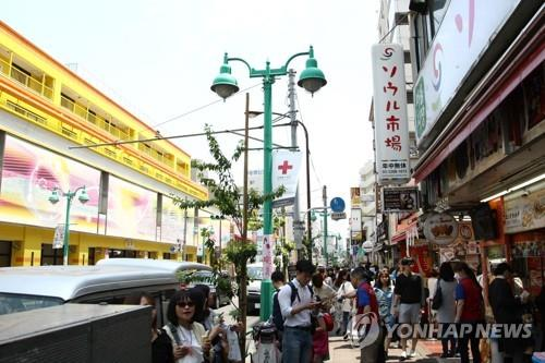 This photo taken May 11, 2019, shows the Korean neighborhood in Shin Okubo, Tokyo, bustling with people. (Yonhap)
