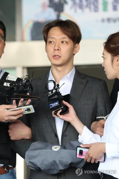 This file photo taken on May 3, 2019, shows K-pop singer-actor Park Yoo-chun responding to reporters at a police station in Suwon, south of Seoul. (Yonhap)