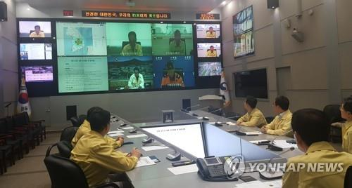 Interior Minister Chin Young (front, R) holds an emergency video conference on July 21, 2019, in this photo provided by the Ministry of the Interior and Safety. (PHOTO NOT FOR SALE) (Yonhap)