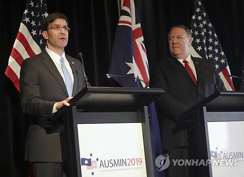This AP photo shows U.S. Secretary of Defense Mark Esper (L) and Secretary of State Mike Pompeo holding a press conference in Sydney on Aug. 4, 2019. (Yonhap)
