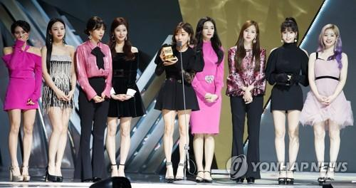This photo of TWICE taking the stage to accept an award at the 2018 MAMA in Hong Kong was provided by CJ ENM. (PHOTO NOT FOR SALE) (Yonhap)