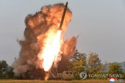 A projectile mounted on a super-large multiple rocket launcher is fired in South Pyongan Province, western North Korea, on Sept. 10, 2019, in this photo released by the North's Korean Central News Agency on Sept. 11. The North tested the launcher under the guidance of North Korean leader Kim Jong-un. (For Use Only in the Republic of Korea. No Redistribution) (Yonhap)