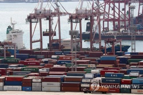 This file photo shows containers carrying export goods in the southeastern city of Busan, South Korea's largest seaport. (Yonhap)