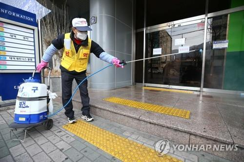 A worker disinfects a church in Daegu, 300 kilometers southeast of Seoul, on Feb. 19, 2020. The country's 31st patient attends the church, with 10 patients judged to be infected at the site. (Yonhap)
