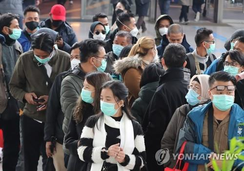 This file photo shows a group of Southeast Asian tourists waiting for a train at Seoul Station in central Seoul on Feb. 21, 2020. (Yonhap)
