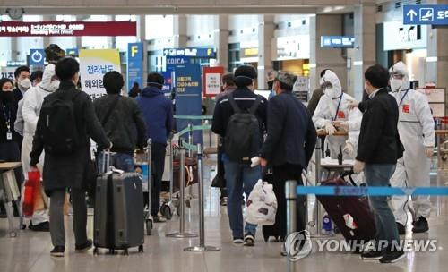 S. Korea's virus infections top 10,000 as cluster, imported cases rise