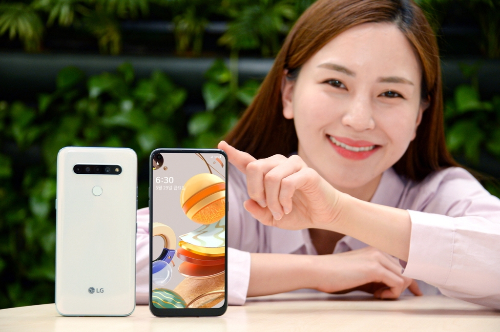 In this photo, provided by LG Electronics Inc. on May 21, 2020, a model introduces LG's new budget smartphone, the Q61. (PHOTO NOT FOR SALE) (Yonhap)