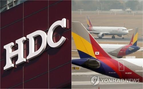HDC's company logo and Asiana Airlines' planes at a airport in South Korea (Yonhap)