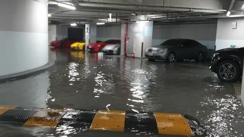 This photo, contributed by a news reader, shows the underground parking space of a high-rise luxury apartment building in Busan hit by flash floods on July 23, 2020. (PHOTO NOT FOR SALE) (Yonhap)