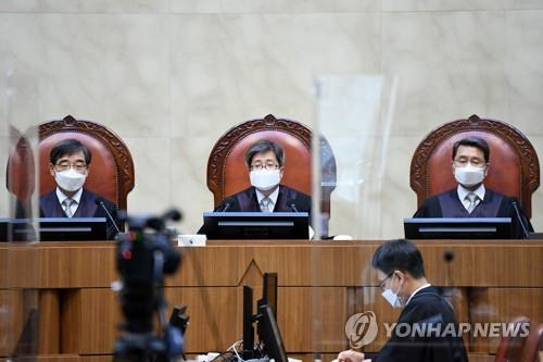 Supreme Court Justices are seated at the court before giving a verdict on Sept. 3, 2020. (Yonhap)