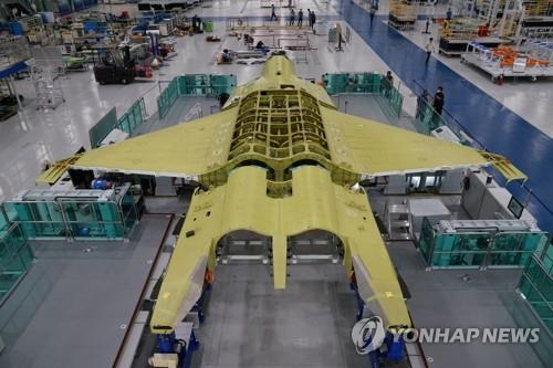 This undated photo provided by the Defense Acquisition Program Administration on Sept. 3, 2020, shows a prototype of South Korea's envisioned fighter jet being assembled at the Korea Aerospace Industries Co. facility in Sacheon, South Gyeongsang Province, southeastern South Korea. Under the KF-X project worth 8.8 trillion won (US$7.3 billion), South Korea has been working since late 2015 to develop a home-grown cutting-edge fighter aircraft to replace the Air Force's aging fleet of F-4 and F-5 jets. (PHOTO NOT FOR SALE) (Yonhap)
