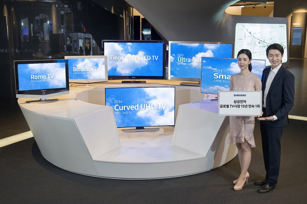 This photo provided by Samsung Electronics Co. on Feb. 24, 2021, shows models introducing the company's TV products. (PHOTO NOT FOR SALE) (Yonhap)