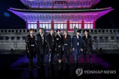 "This photo, provided by Big Hit Music on Sept. 29, 2020, shows BTS posing for a photo in front of Geunjeongjeon Hall of Gyeongbok Palace in Seoul, South Korea, where the band filmed a performance for the ""BTS Week"" special on NBC's ""The Tonight Show Starring Jimmy Fallon"" in the United States. (PHOTO NOT FOR SALE) (Yonhap)"