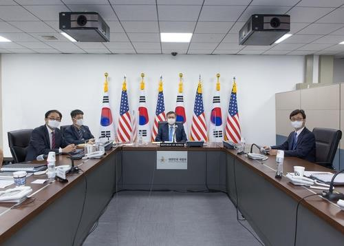 This photo, provided by the defense ministry, shows Deputy Defense Minister Chung Suk-hwan (C) during the biannual 18th Korea-U.S. Integrated Defense Dialogue (KIDD) that the two countries held via videoconferencing on Sept. 9 and Sept. 11, 2020. (PHOTO NOT FOR SALE) (Yonhap)