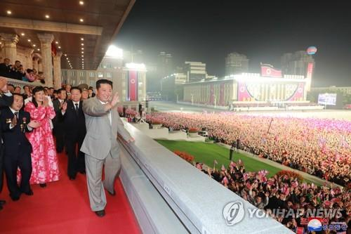 North Korean leader Kim Jong-un (front) acknowledges the crowd during a military parade at Kim Il-sung Square in Pyongyang on Sept. 9, 2021, to celebrate the 73rd anniversary of the country's founding, in this photo released by the North's official Korean Central News Agency. (For Use Only in the Republic of Korea. No Redistribution) (Yonhap)
