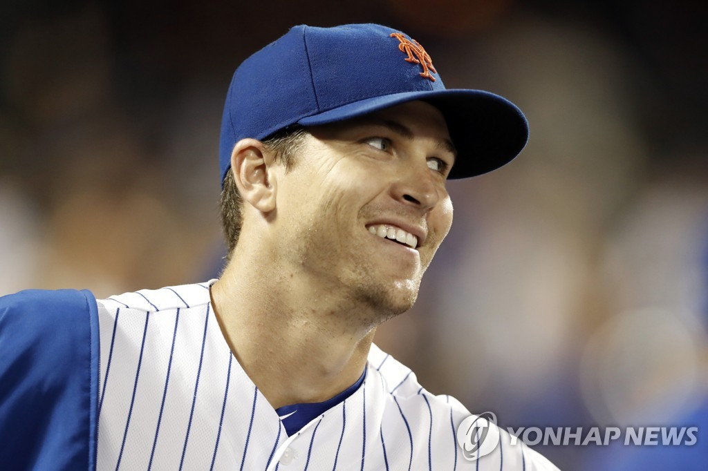 In this Associated Press photo, New York Mets' starter Jacob deGrom smiles after pitching seven innings against the Arizona Diamondbacks in their Major League Baseball regular season game at Citi Field in New York on Sept. 9, 2019. (Yonhap)