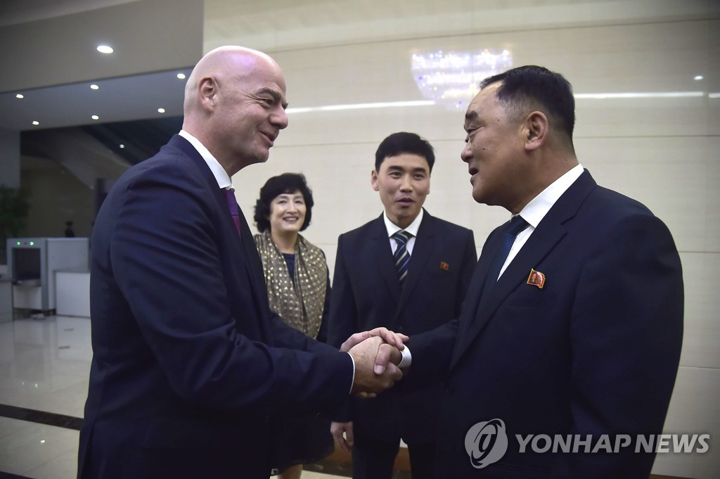 In this AFP photo, FIFA President Gianni Infantino (L) shakes hands with Kim Jang-san (R), secretary general of the North Korean Football Association, upon his arrival at Pyongyang Sunan International Airport in Pyongyang on Oct. 15, 2019, for a World Cup qualifying match between South Korea and North Korea. (Yonhap)