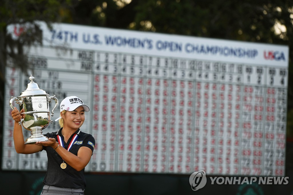 In this AFP file photo from June 2, 2019, Lee Jeong-eun of South Korea holds the championship trophy after winning the U.S. Women's Open at the Country Club of Charleston in Charleston, South Carolina. (PHOTO NOT FOR SALE) (Yonhap)