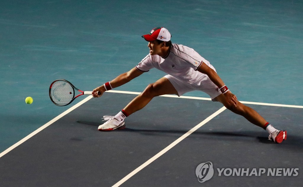 In this Reuters photo, Kwon Soon-woo of South Korea stretches for a shot against Rafael Nadal of Spain in the quarterfinals match at the Mexican Open on the ATP Tour at Princess Acapulco Stadium in Acapulco, Mexico, on Feb. 27, 2020. (Yonhap)
