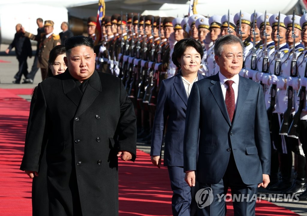 In this file photo, taken on Sept. 20, 2018, South Korean President Moon Jae-in (R) and North Korean leader Kim Jong-un review an honor guard at Samjiyon Airport, after arriving for an excursion to Mount Paekdu. (Pool photo) (Yonhap)