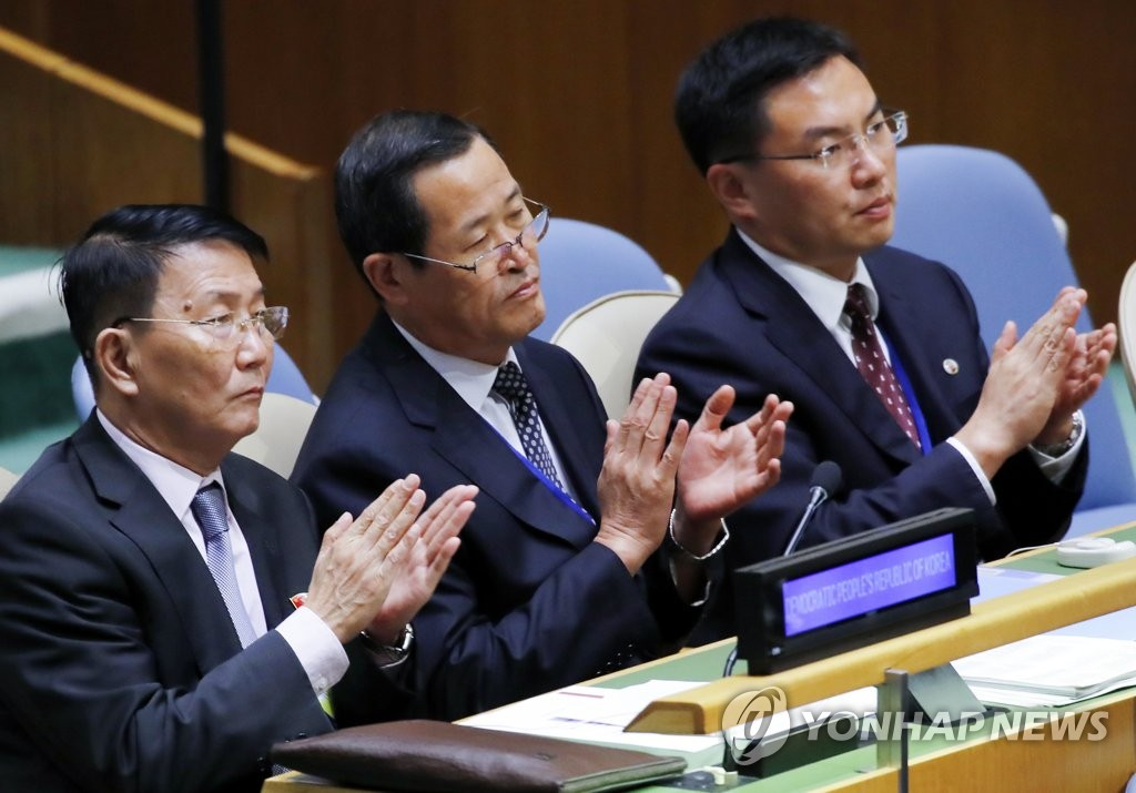 In this file photo, taken on Sept. 26, 2018, Kim Song (C), North Korean ambassador to the United Nations, and other North Korean officials applaud at the end of South Korean President Moon Jae-in's speech at the U.N. General Assembly in New York. Moon said North Korea is on the path toward denuclearization and that it's now time for the international community to respond to the North's new efforts. (Yonhap)
