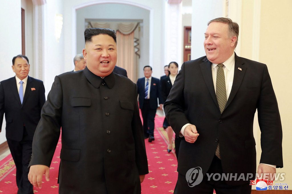 This AP photo shows U.S. Secretary of State Mike Pompeo (R) with North Korean leader Kim Jong-un in Pyongyang on Oct. 7, 2018. (Yonhap)