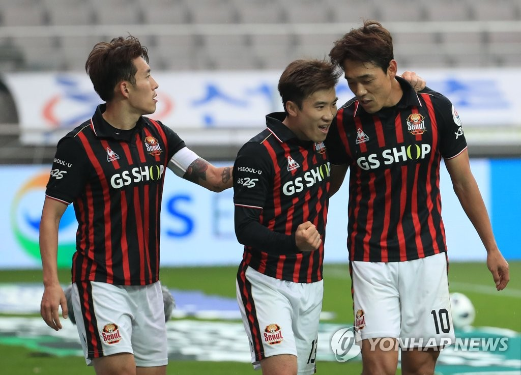 In this file photo taken Nov. 11, 2018, FC Seoul's Park Chu-young (R) speaks with teammate Go Yo-han (C) after scoring a goal against Jeonnam Dragons in a K League 1 match in Seoul. (Yonhap)