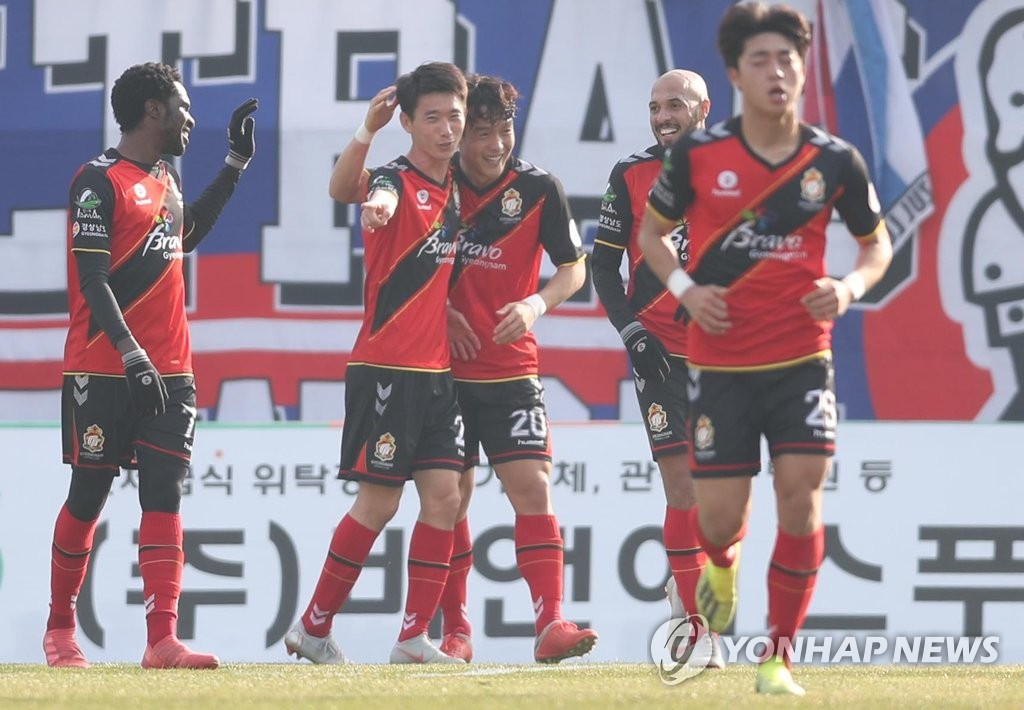 This file photo, taken Nov. 25, 2018, shows Gyeongnam FC players celebrating after scoring a goal against Suwon Samsung Bluewings in a K League 1 match at Changwon Football Centre in Changwon, South Gyeongsang Province. (Yonhap)