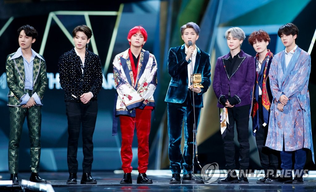 This file photo provided by CJ ENM shows BTS on stage during the Mnet Asian Music Awards at AsiaWorld Arena in Hong Kong on Dec. 14, 2018, after winning the Artist of the Year honors. (Yonhap)