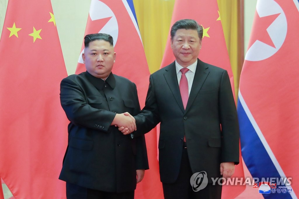 Chinese President Xi Jinping (R) shakes hands with North Korean leader Kim Jong-un at the Great Hall of the People in Beijing on Jan. 8, 2019, in this photo released by the North's official Korean Central News Agency. (For use only in the Republic of Korea. No redistribution) (Yonhap)