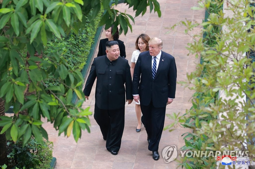 North Korean leader Kim Jong-un (L) and U.S. President Donald Trump take a stroll at the Sofitel Legend Metropole hotel in Hanoi on Feb. 28, 2019, in this photo carried by the North's official Korean Central News Agency the next day. (For Use Only in the Republic of Korea. No Redistribution) (Yonhap)
