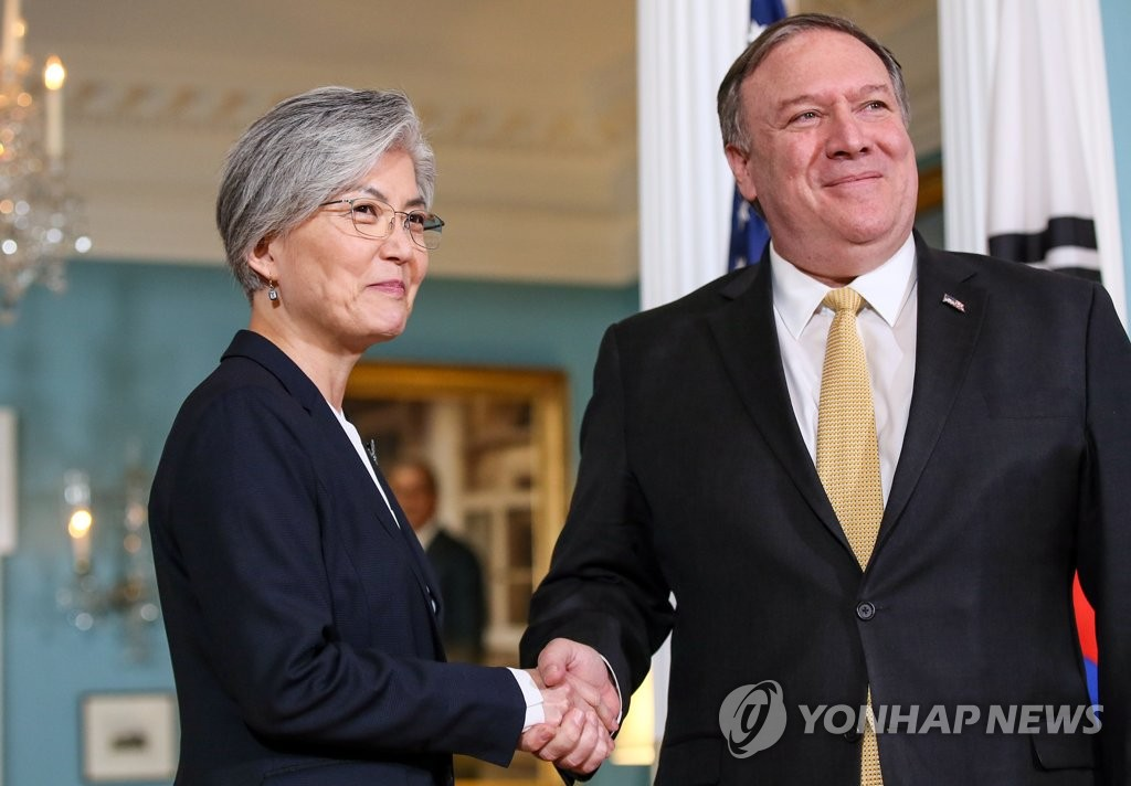 This file photo, taken March 30, 2019, shows Foreign Minister Kang Kyung-wha (L) shaking hands with U.S. Secretary of State Mike Pompeo before their talks in Washington. (Yonhap)
