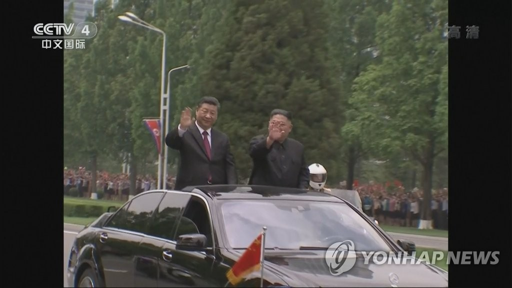 Xi riding in parade through Pyongyang