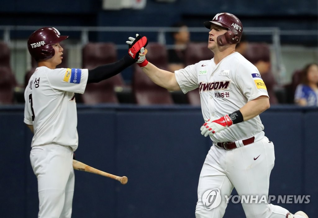 Jerry Sands of the Kiwoom Heroes (R) high-fives teammate Kim Hye-seong after hitting a two-run home run against the Samsung Lions in the bottom of the second inning of a Korea Baseball Organization regular season game at Gocheok Sky Dome in Seoul on July 17, 2019. (Yonhap)
